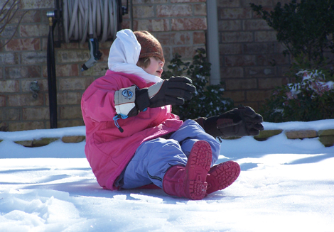 My daughter, enjoying the recent global warming in Tennessee.  (Her hands arent actually that big.)
